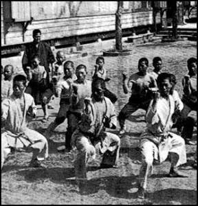 Founder of Goju-ryu Karate, Chojun Miyagi (1888-1953), teaching Karate. Photo taken in 1929